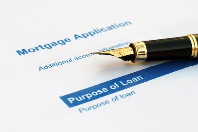 Picture of Mortgage Application with a pen laying on a sheet